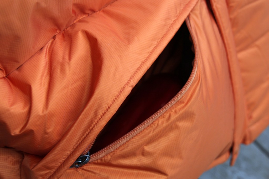 Marmot Parka pocket open with bottle inside