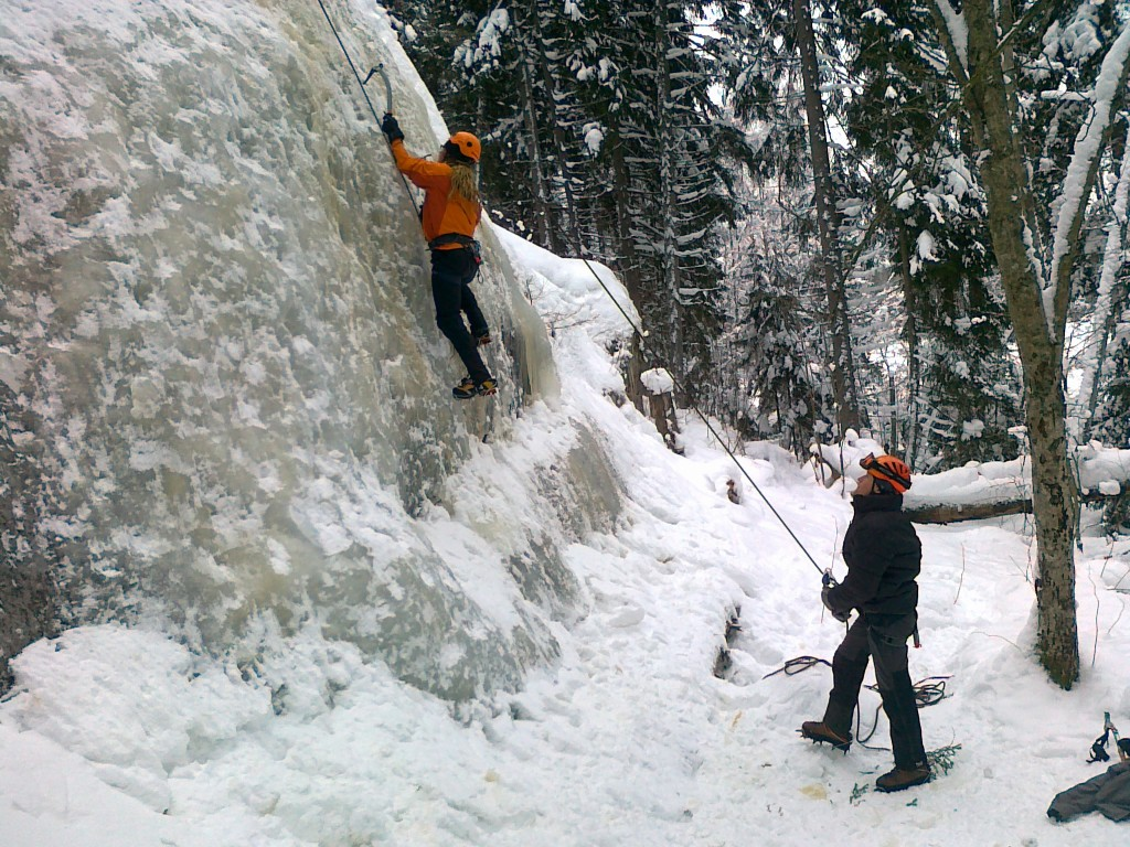 Me climbing and Ilkka belaying
