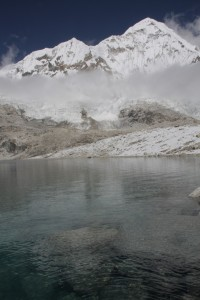 Crystal clear mountain lake between Baruntse and Amphulapcha