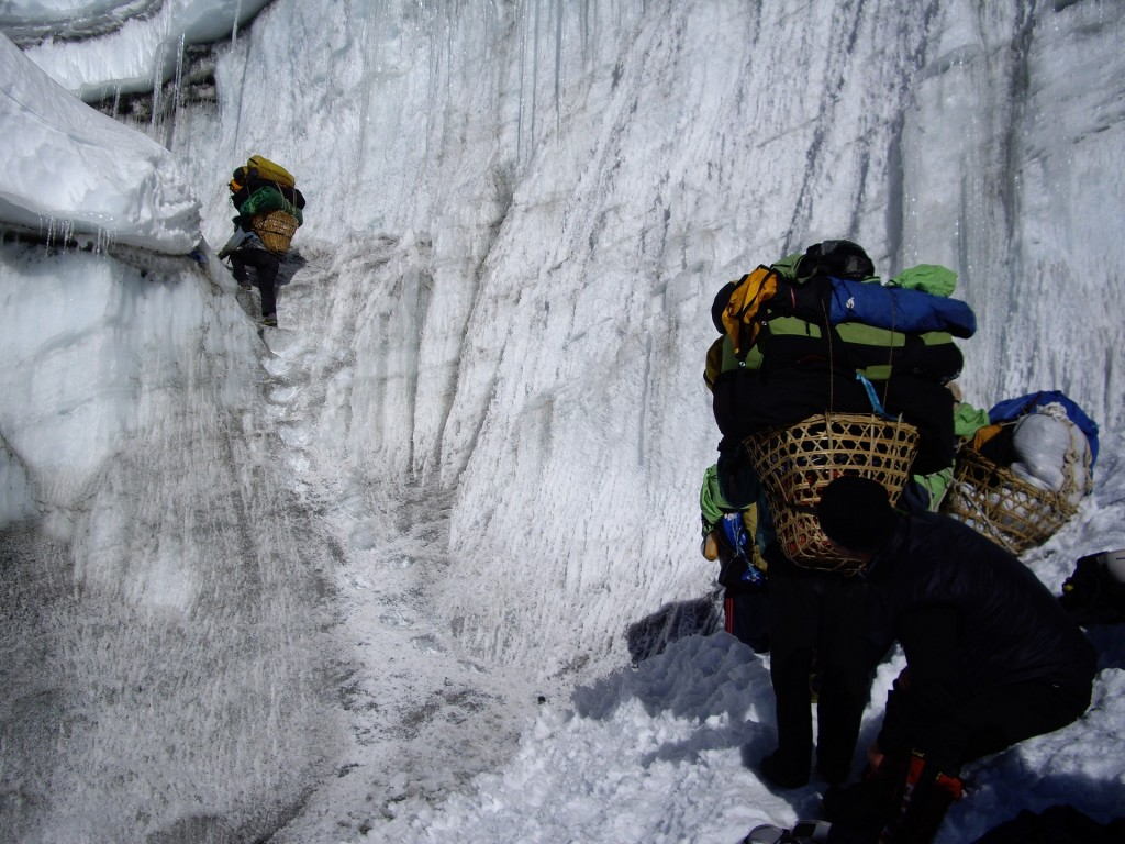 Porters climbing up the steps on the Amphulapcha glacier