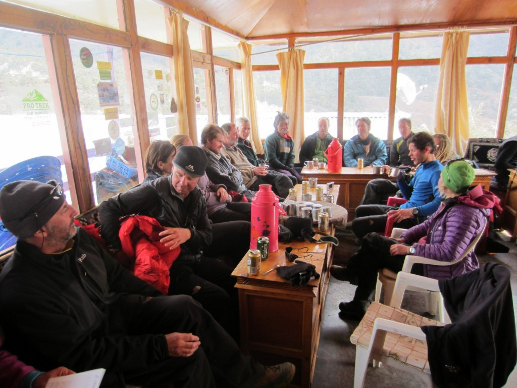 The common room of our Pengboche lodge and our team having an afternoon drinks