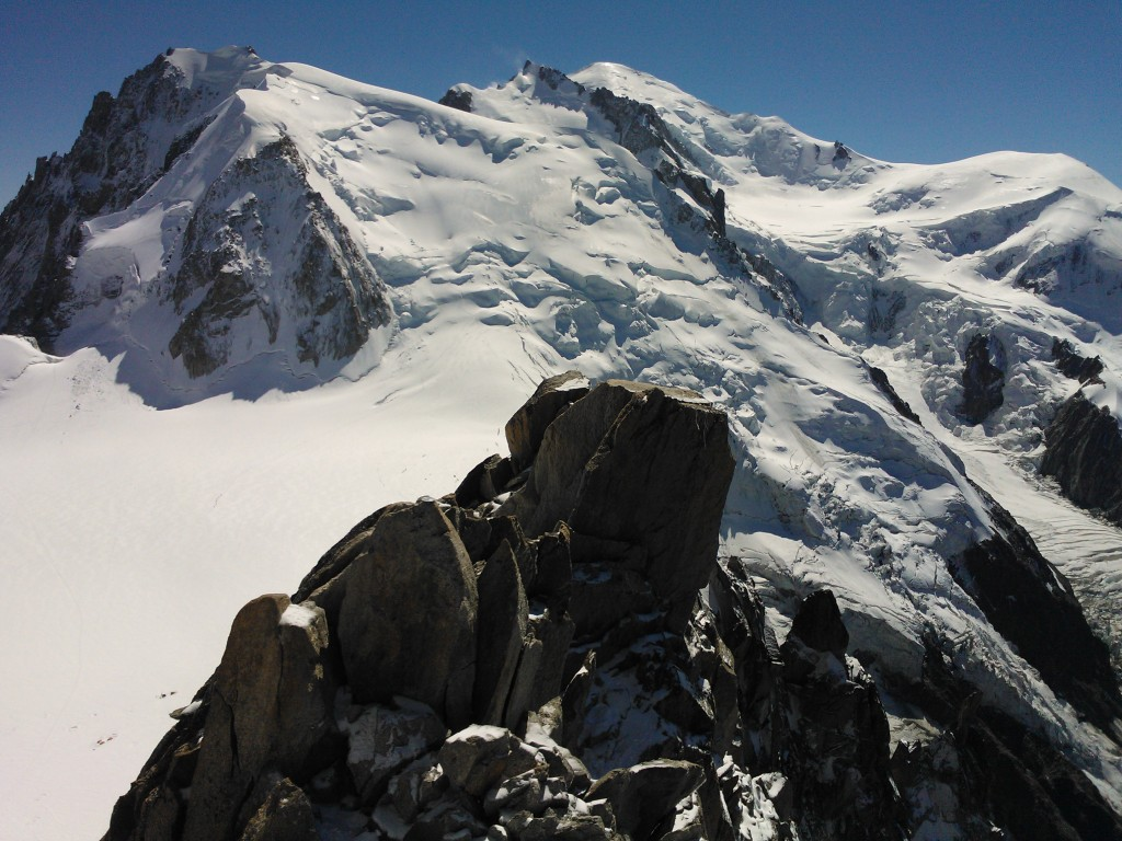 Mont Blanc scenery. End of Cosmiques arete in the foreground and in the back from left Mont Blanc du Tacul, Mont Maudit, Mont Blanc and Dôme du Goûter