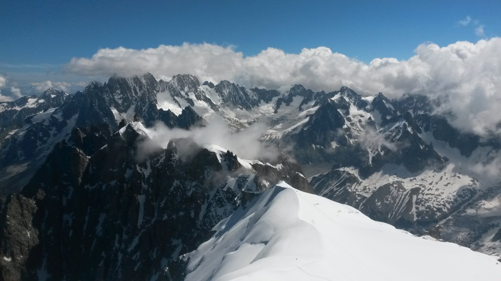 The view from the top viewing platform of the Aiguille du Midi towards the Aiguille du Plan. The traverse route follows the ridge statring in from mid foreground.