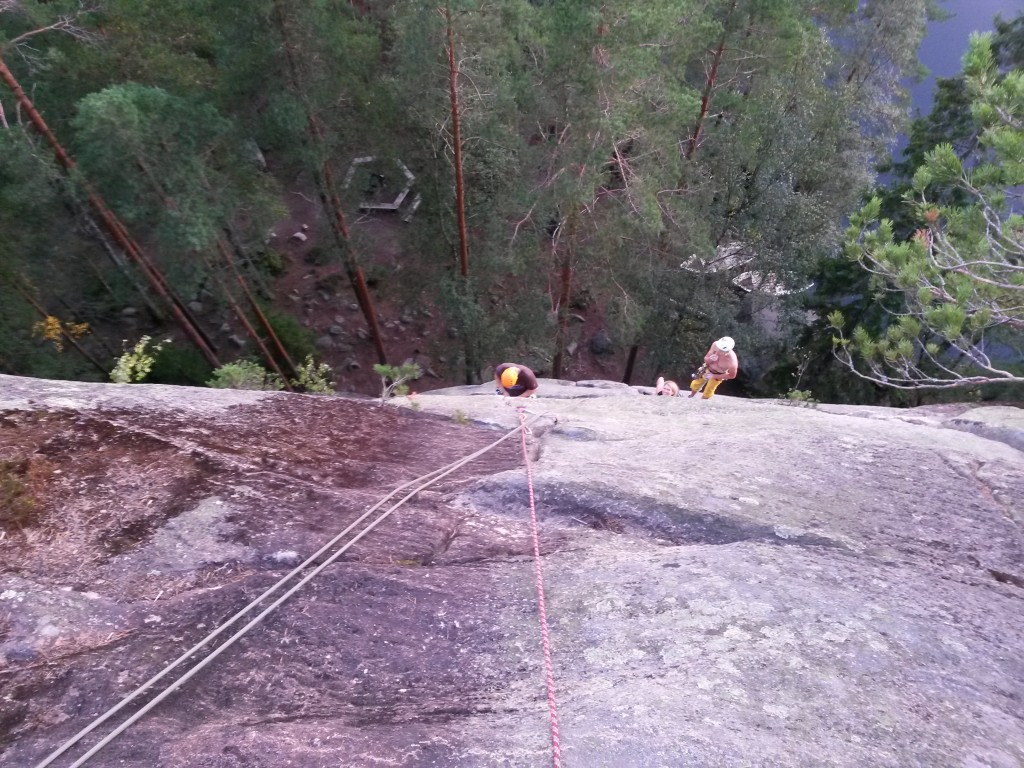 Looking down and belaying Jason up the Mänty. Another party abseiling down via the middle anchors.