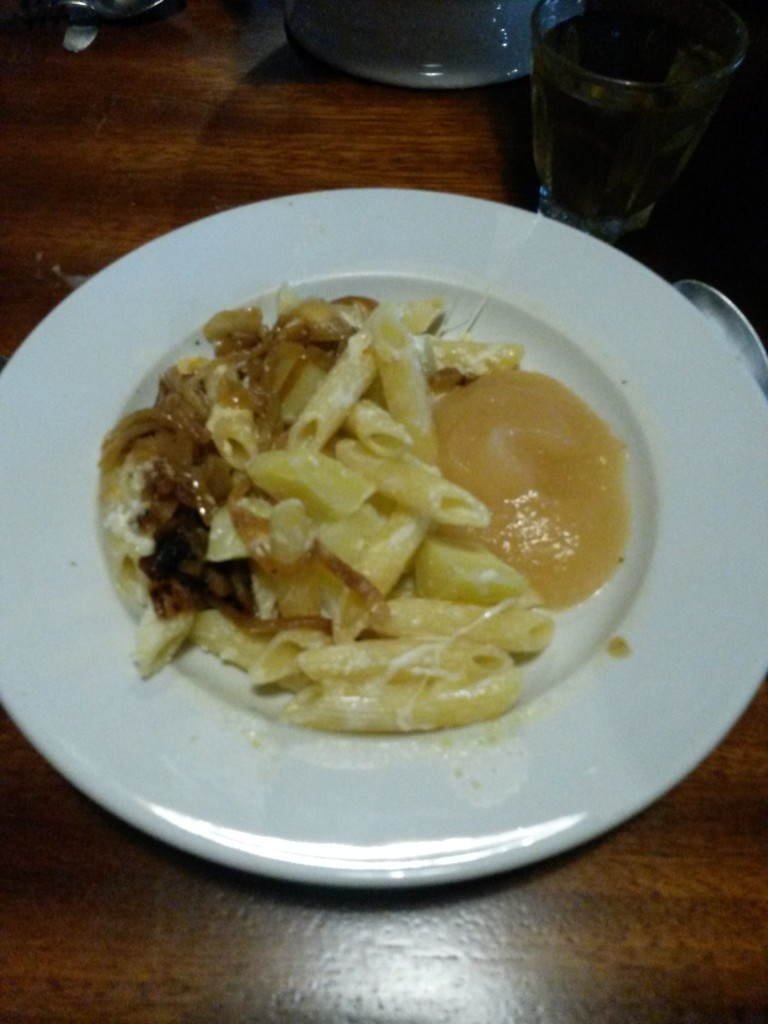 Staple food in the Swiss alps: Pasta, potatoes, sauteed onions and apple sauce to give the mix an odd twist