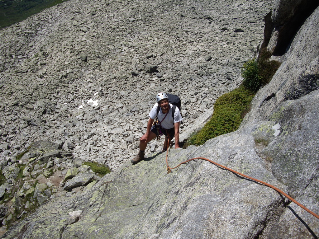 The first pitch of the Hochschijen South Ridge. Markus decided to try to do some of the climbing in trekking boots, but had to change into real climbing shoes already on the second pitch.