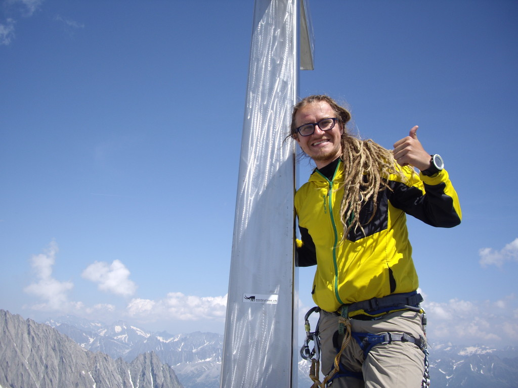 The summit pose. You can btw just barely see the summit needle of Salbitschijen left of the cross.
